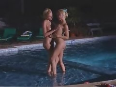 Lesbian caresses girlfriend in water