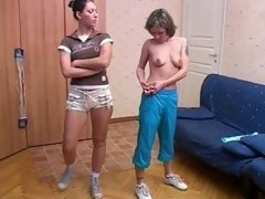 Cute girl undressed and trained by a lesbian coach