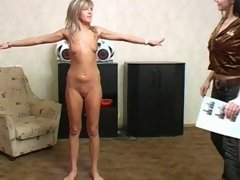 Gymnast gets naked and does lesbian exercises
