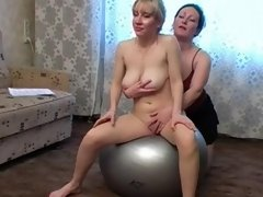 Big-boobed nude chick satisfied by a lesbian instructor