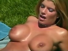 Two young lezzies with perky tits make sex outdoor