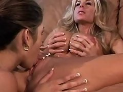 Attractive lesbian babes make love